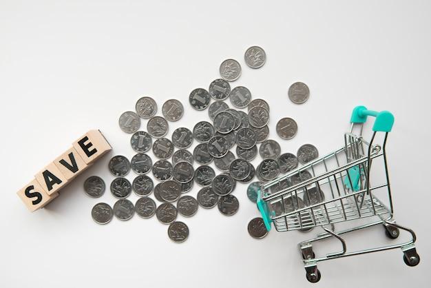単語とショッピングカートのトップビューコイン