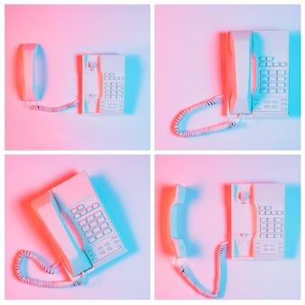 ピンクの背景の上の固定電話のセット