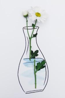 描かれた花瓶と紙の上に置かれた新鮮な花