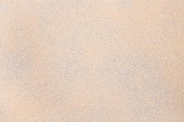 ベージュの大理石のテクスチャ背景のクローズアップ