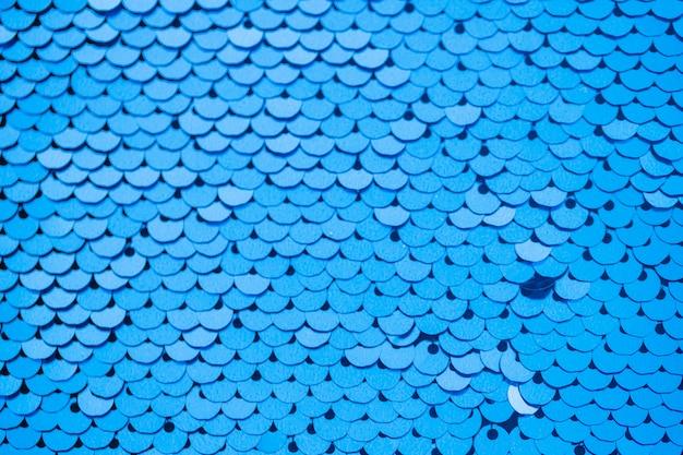 フルフレームの抽象的な背景ブルー反射スパンコール