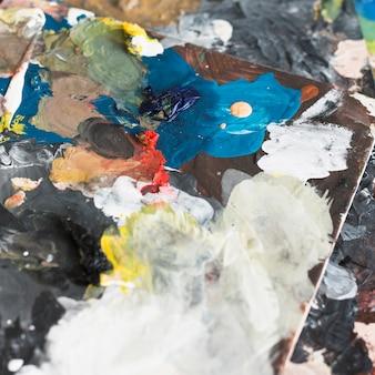 アーティストのオイル塗料の色とりどりの抽象的な背景