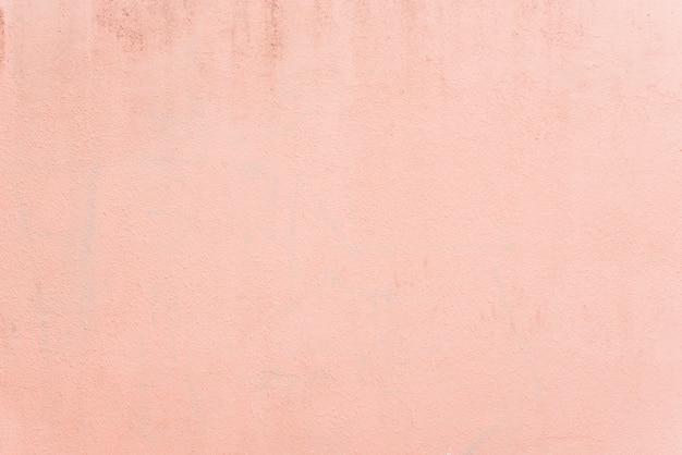 淡いパステル調のピンクの質感の壁の背景