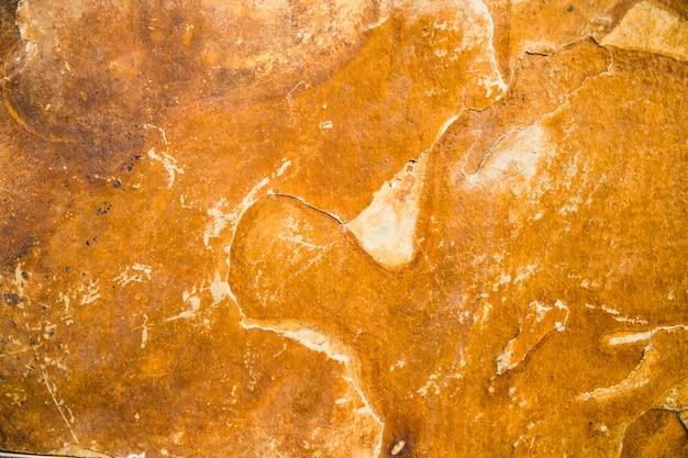 黄色の大理石のテクスチャ石の背景