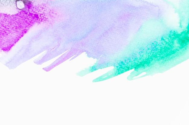紫と緑のブラシをかけられた抽象的な背景