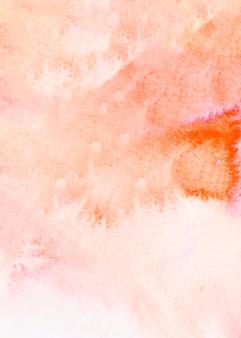 抽象的なオレンジ色の水彩ブラシをかけられたテクスチャ背景