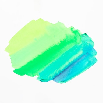 白い背景に分離された緑と青の色合いの水彩画の汚れ