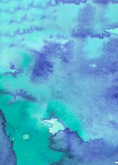 青とターコイズ色の水彩テクスチャ背景