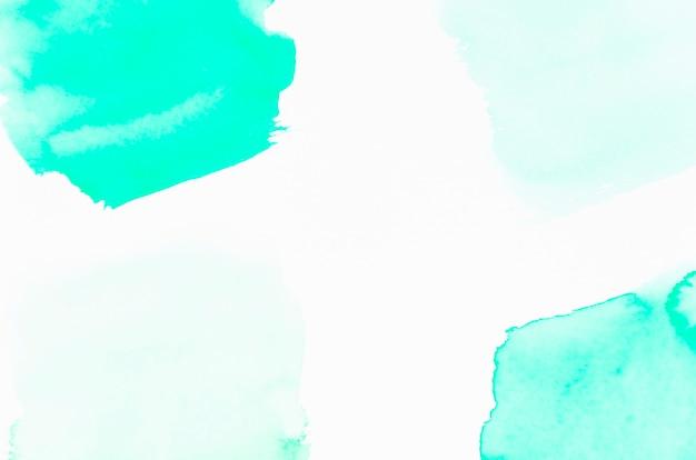 白地にターコイズブルーの水彩デザイン