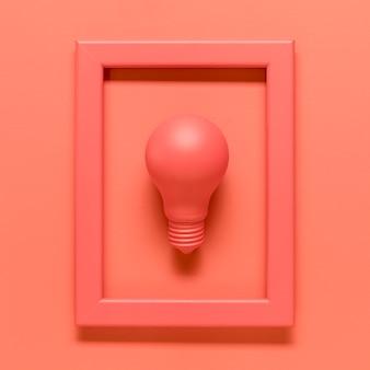 Розовая композиция с лампой в рамке на цветной поверхности
