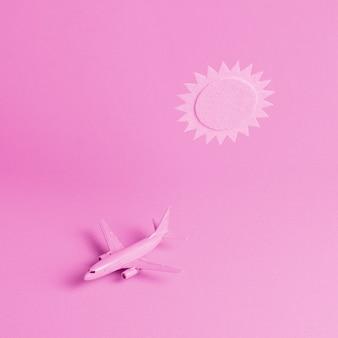 飛行機と太陽とピンクの背景