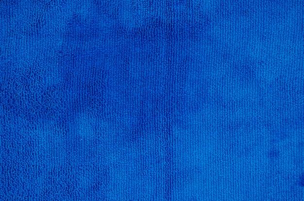 青い柔らかいナプキンの背景のフルフレーム