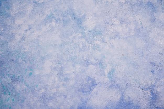 青い塗られた壁のテクスチャ背景