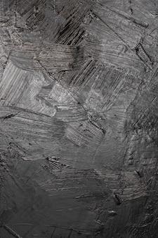 芸術的な黒いペンキテクスチャ背景