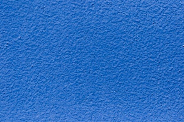 クローズアップの塗られた壁のテクスチャ