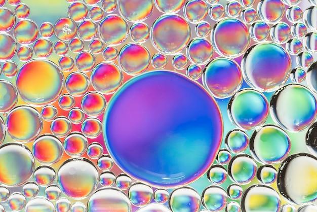 別の虹の抽象的な泡の質感