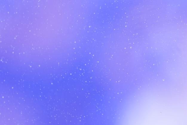 泡と紫の抽象的な背景