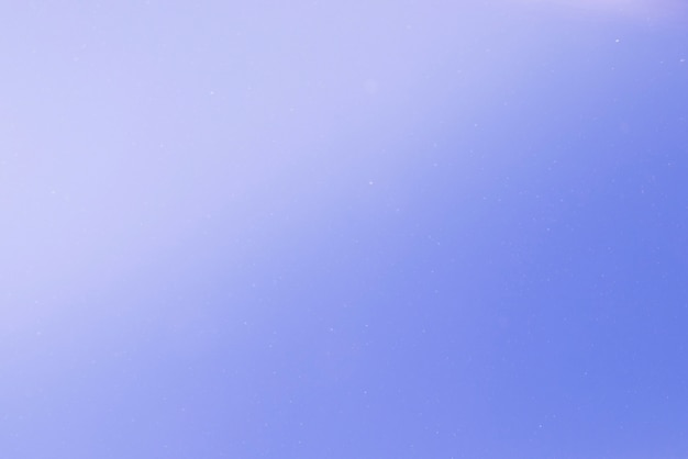 光スポットと青の抽象的な背景