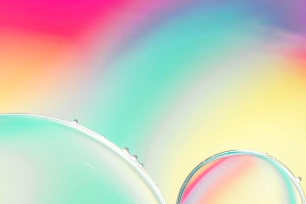 泡とブルーのピンクと黄色の抽象的な背景