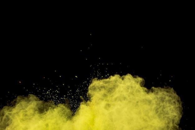 Красочное завитое облако желтого порошка