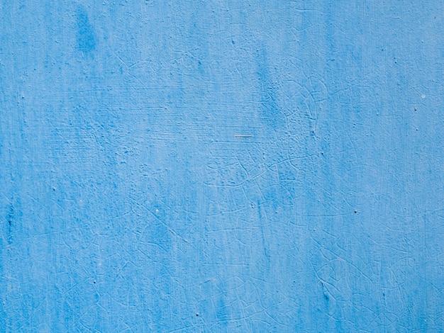 青い塗られたテクスチャ壁の背景