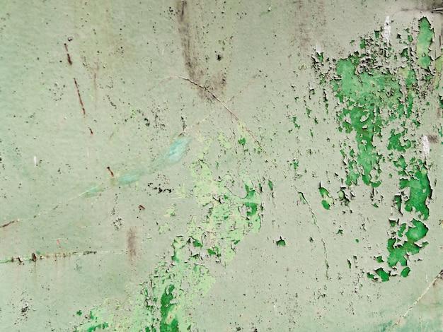 皮をむいた古い壁の背景