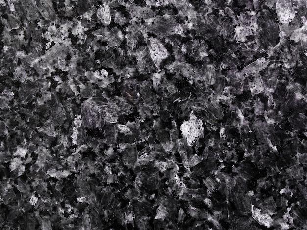 花崗岩の石の暗いテクスチャ背景