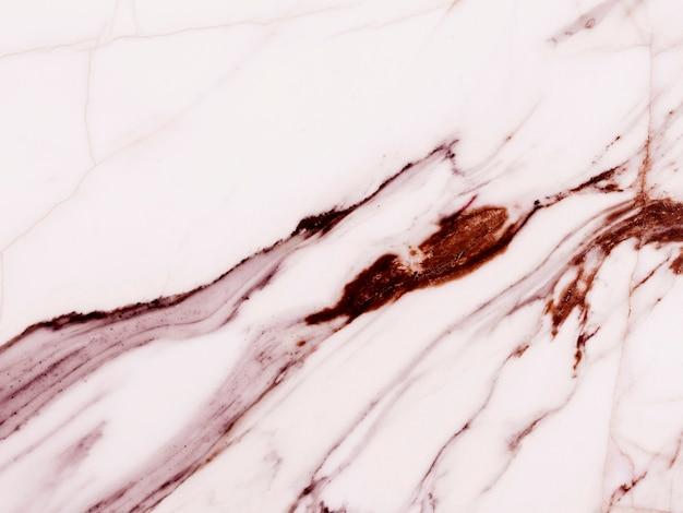 自然な模様のあるピンクの大理石