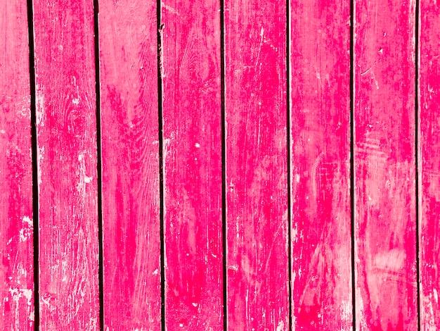 ヴィンテージのピンクの木の板の背景