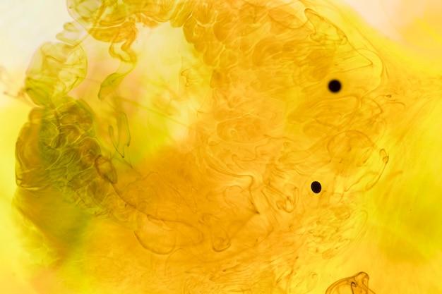 黒のドットと黄色の抽象的な煙