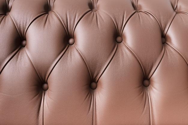 クローズアップの革のソファの質感