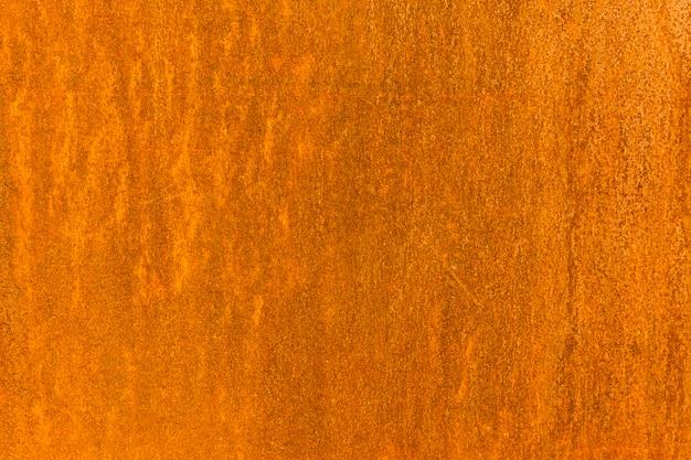 ノイズとオレンジ色の無地の背景