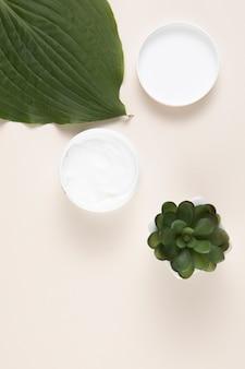 Плоская прокладка масла для тела с простым фоном