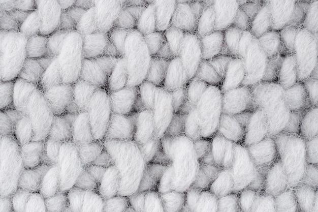 白いウールのかぎ針編みパターンのクローズアップ