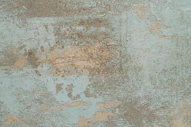 き裂を有する古い青いコンクリート背景