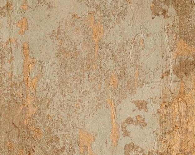 古いひびの入った茶色のコンクリートの背景
