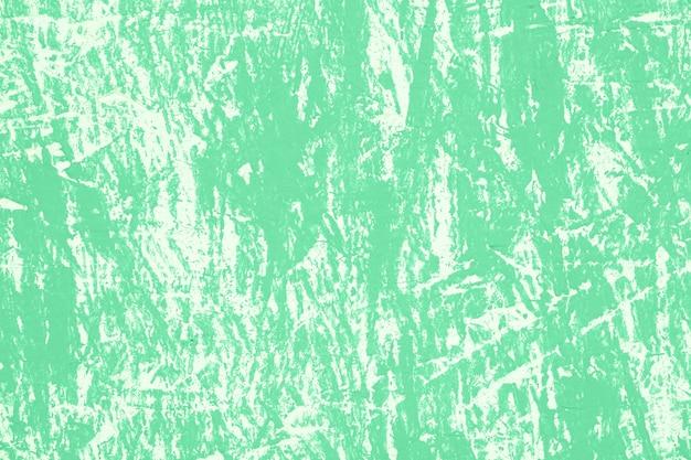 傷のある緑のヴィンテージの壁