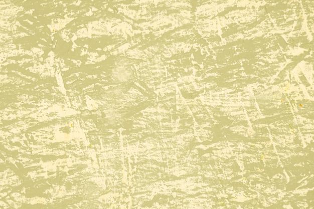 傷のあるベージュのヴィンテージの壁