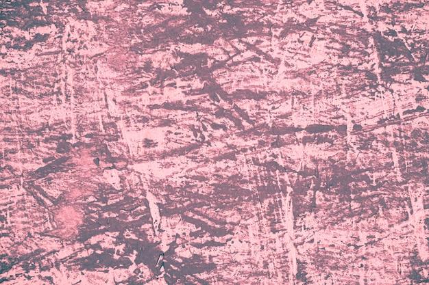 傷のあるピンクのヴィンテージの壁