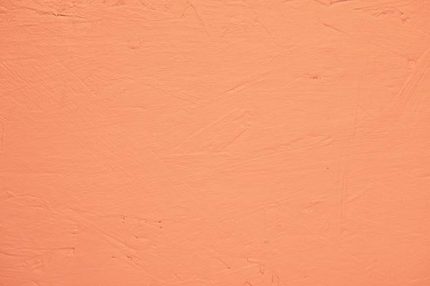 オレンジ塗装のテクスチャ壁