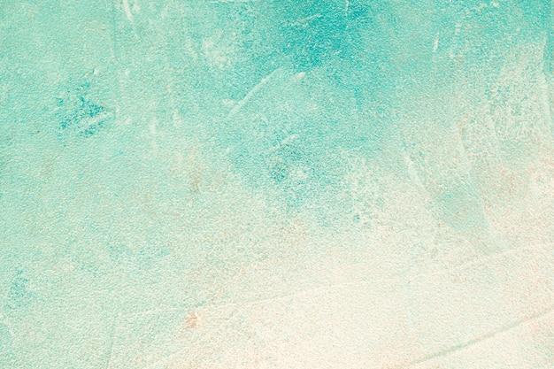 ターコイズ色のコンクリートの壁の背景