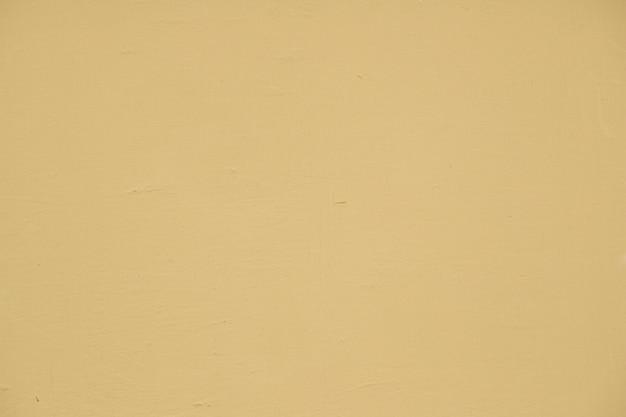 空のベージュ塗装のテクスチャ壁