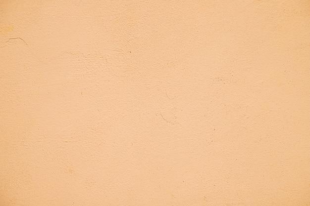 空のオレンジ塗装のテクスチャ壁