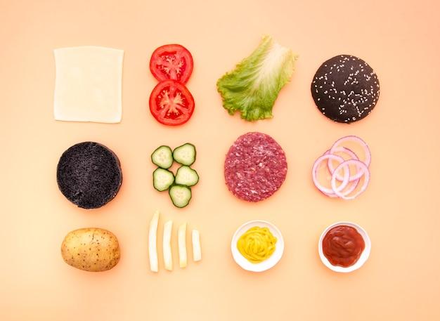 Плоский набор ингредиентов гамбургера