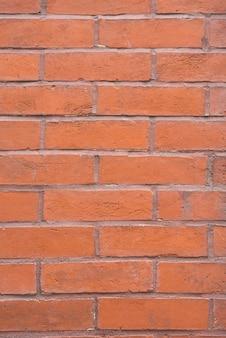 オレンジ色のレンガの壁の背景
