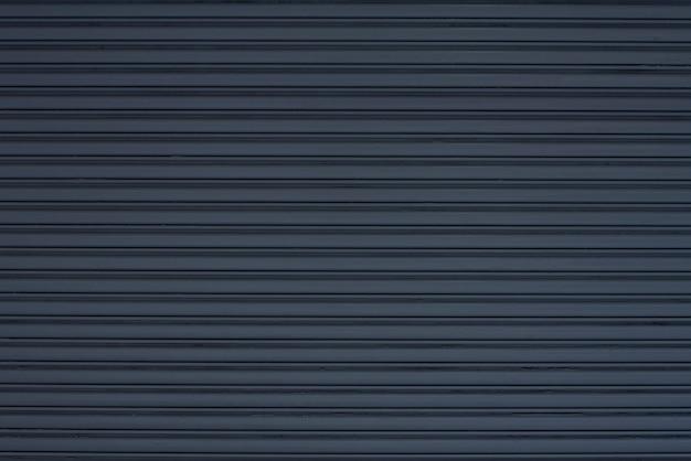 黒い金属壁の背景