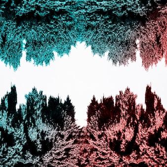 白い背景に分離した赤と青の磁気金属シェービング
