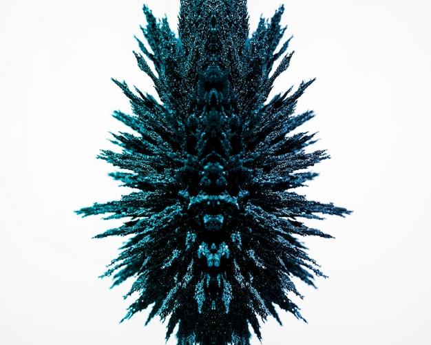 白い背景に分離された青い磁気金属シェービングの設計