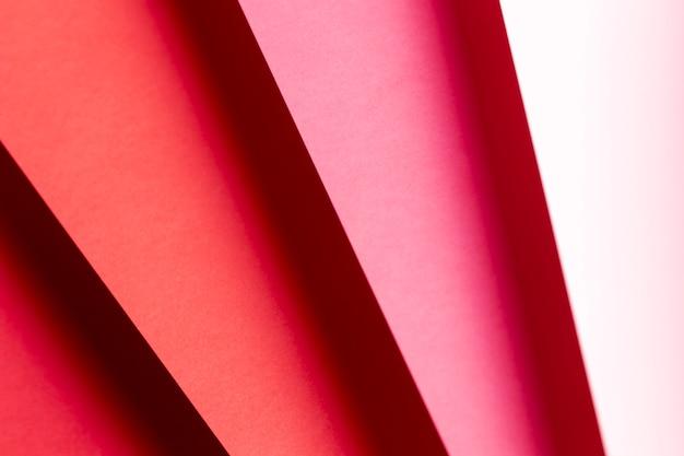 フラットは、赤い紙のクローズアップのさまざまな色合いを置く
