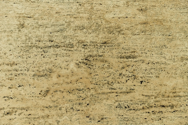ベージュの大理石の表面テクスチャ背景